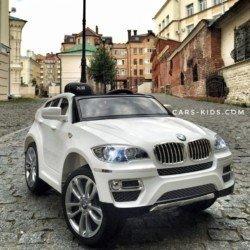Электромобиль BMW X6 белый (колеса резина, кресло кожа, пульт, музыка, глянцевая покраска)